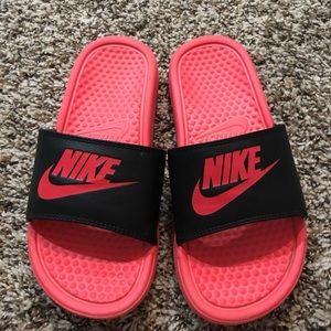 Red/pink nike slides